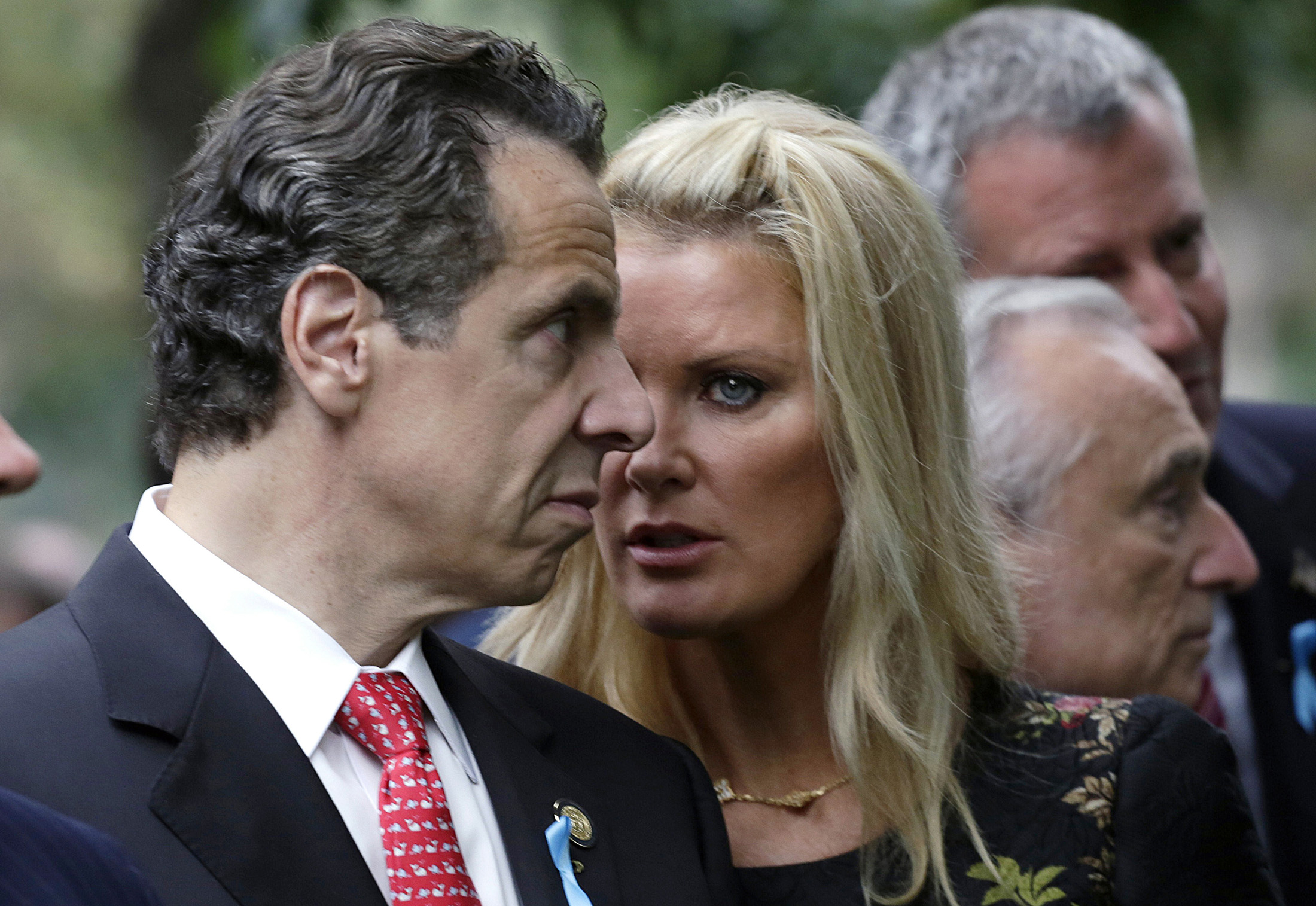 New York Governor Andrew Cuomo and his partner Sandra Lee talk during memorial observances held at the site of the World Trade Center in New York