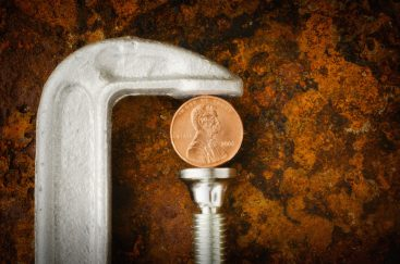 Studio shot of coin in vise grip